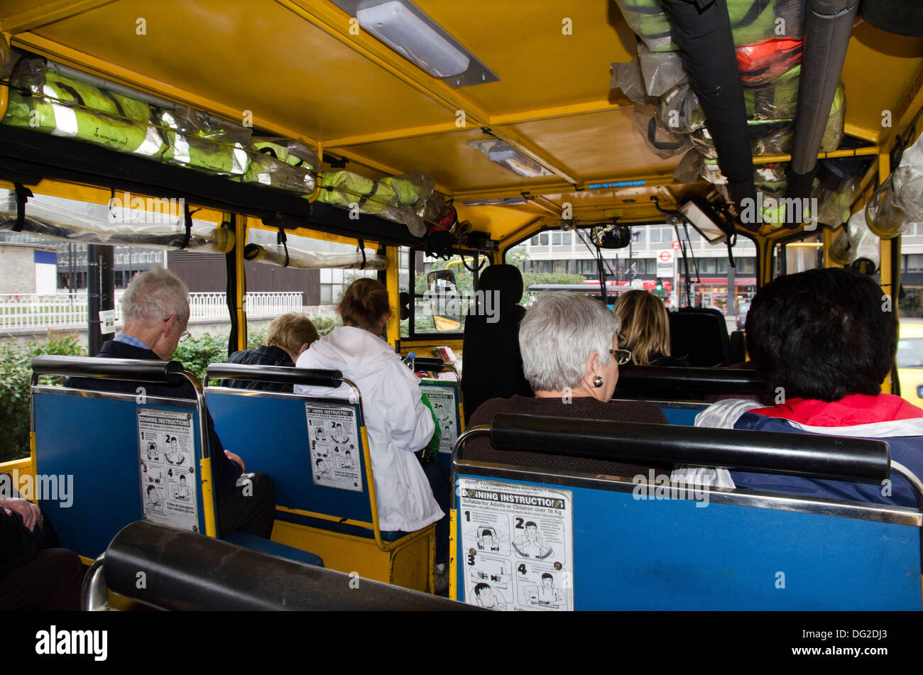 inside of london duck tours amphibious vehicle desdemona with tourists - Stock Image