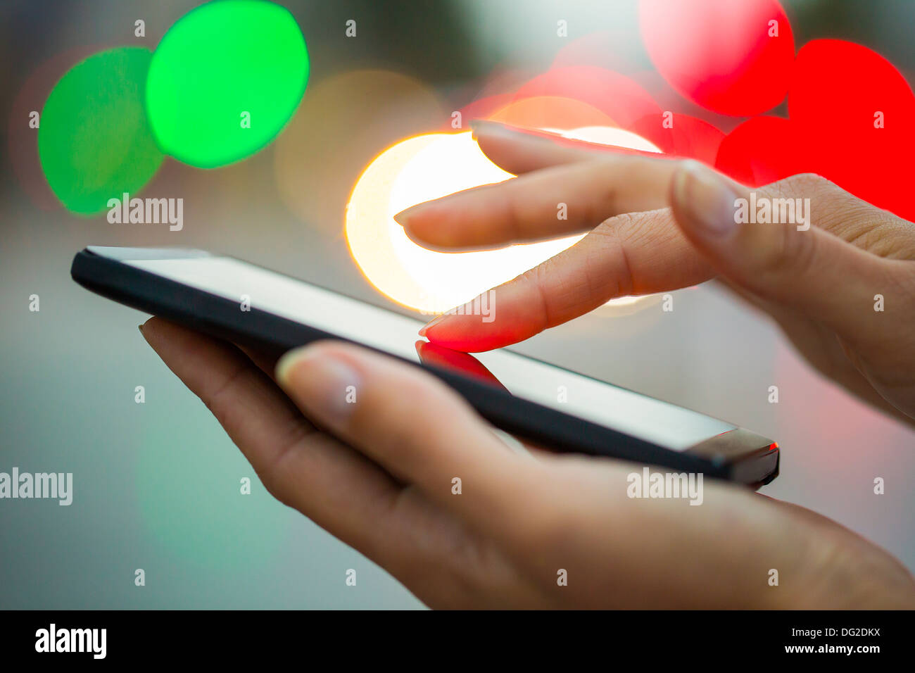 Female outdoor mobile phone city sms message - Stock Image
