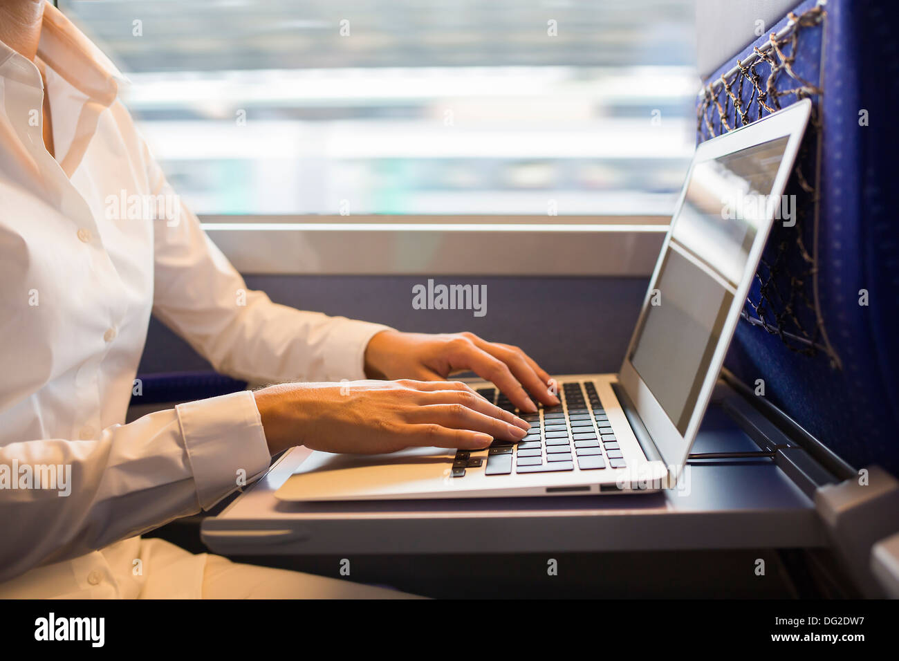 Female finger computer seating wagon - Stock Image