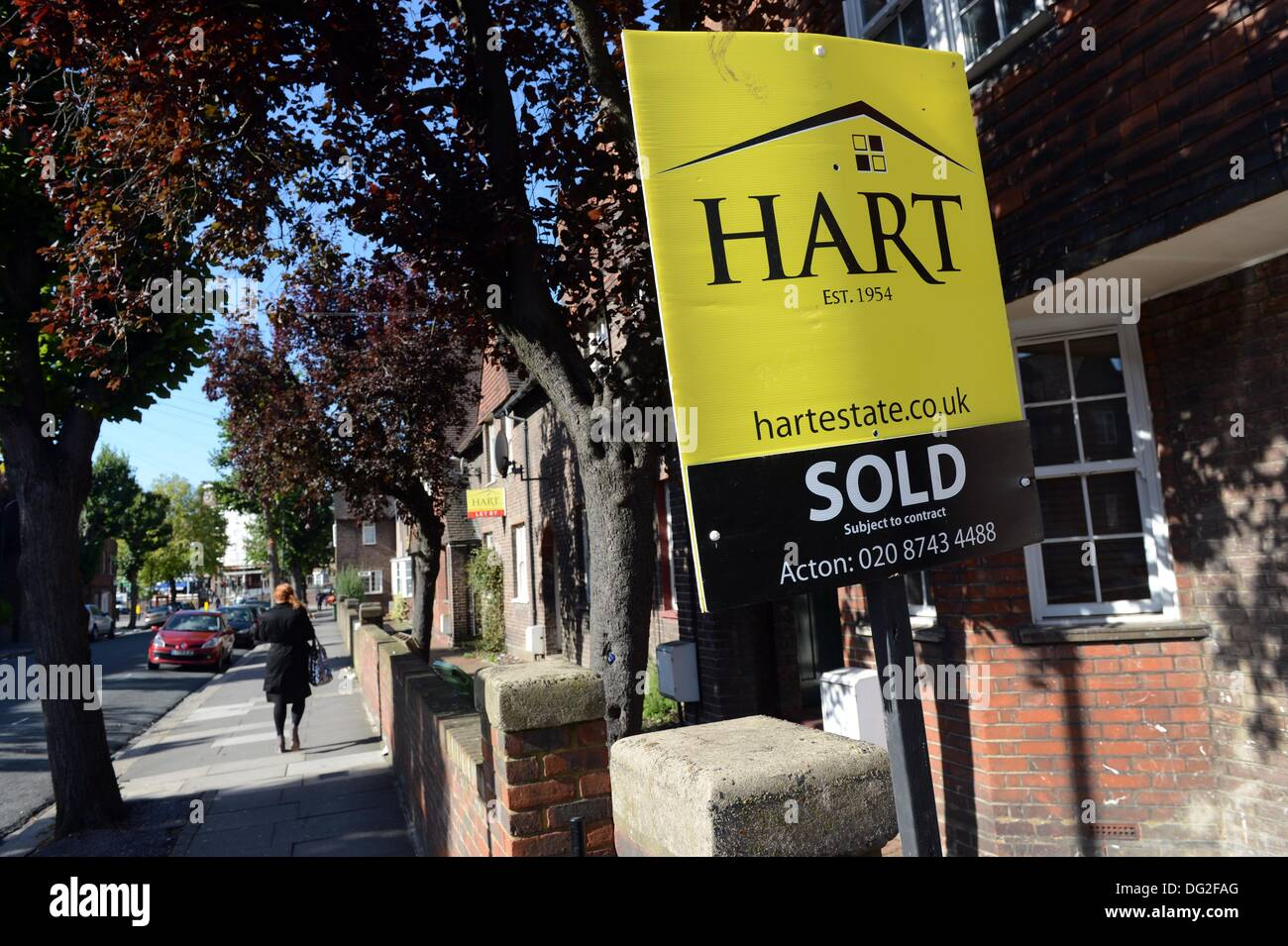 """London, Great Britain. 16th Sep, 2013. """"Sold"""" is written on a real estate sign outside of a home in London, Great Stock Photo"""
