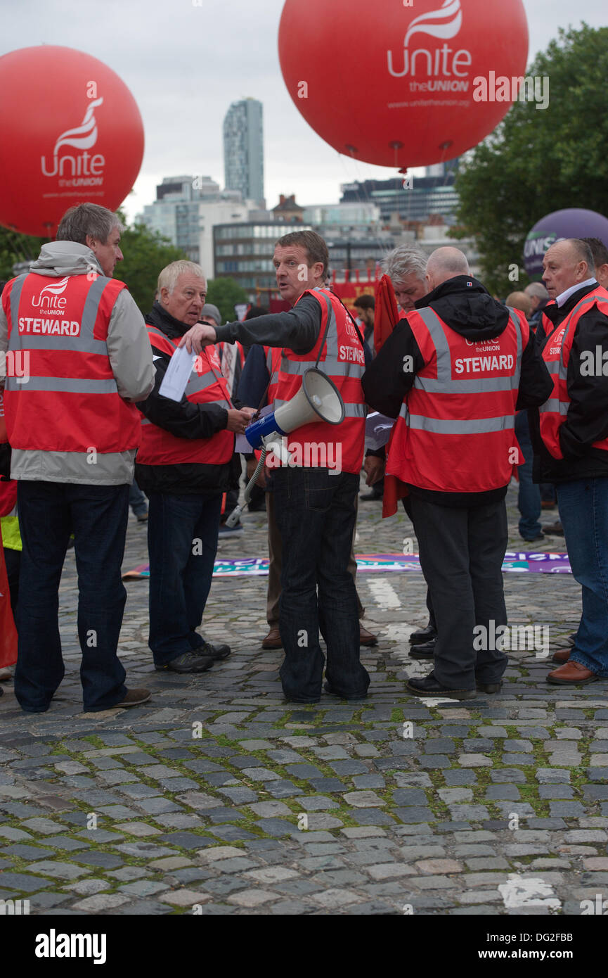 Liverpool, England, UK. Saturday 12th October 2013. Stewards at the march from  Unite the Union. Around 7000 people marched through Liverpool city centre for a march against fascism organised by Unite the Union. As part of a national day of protest, trade unions and anti-racism groups led the rally through the city centre. A major focus of the event was a message that far-right BNP (British National Party) leader Nick Griffin must be defeated at the Euro elections next year. - Stock Image