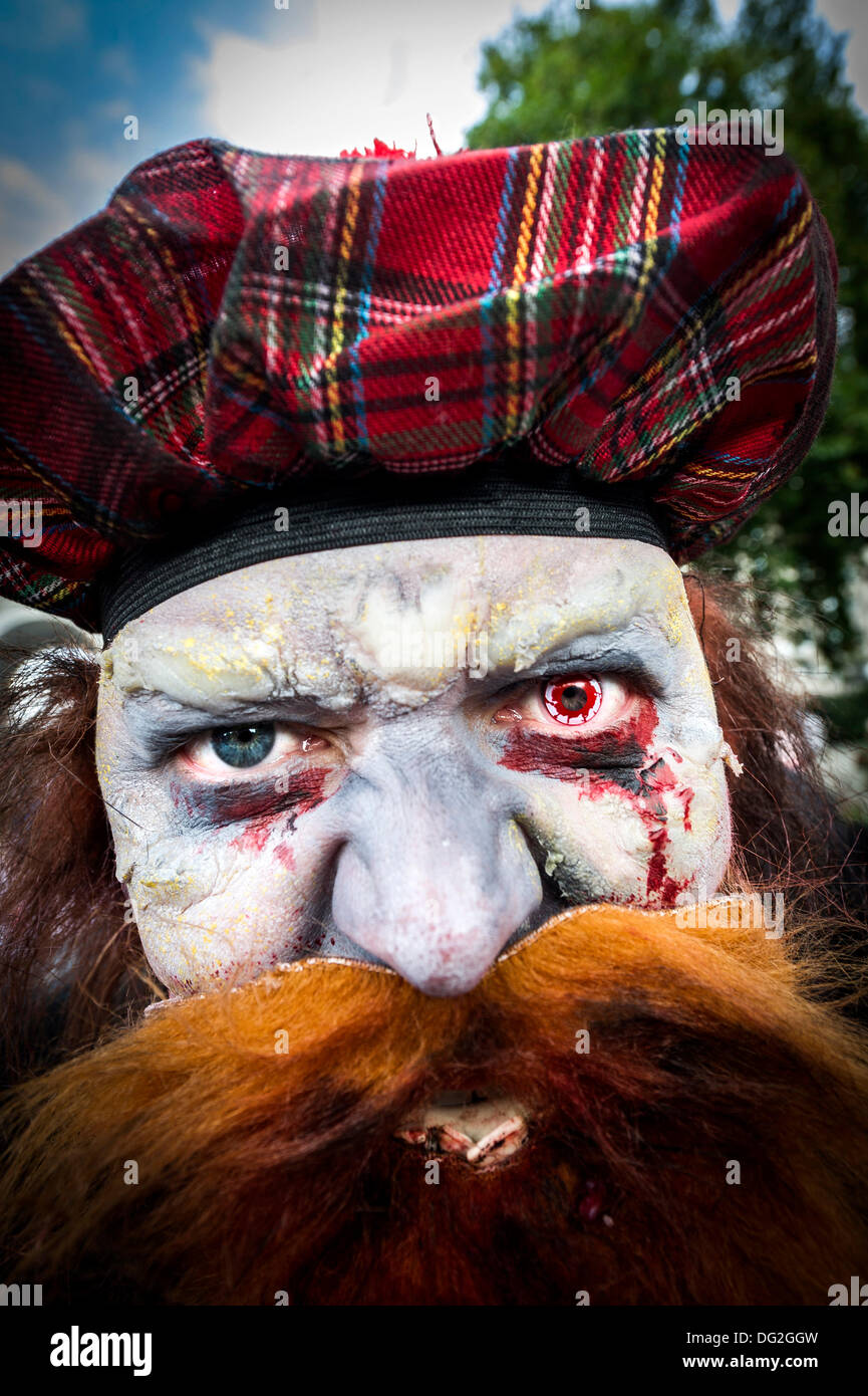 October 12th 2013 A participant in the annual Zombie Invasion of London finishing his makeup.  Photographer: Gordon Scammell/Alamy Live News - Stock Image