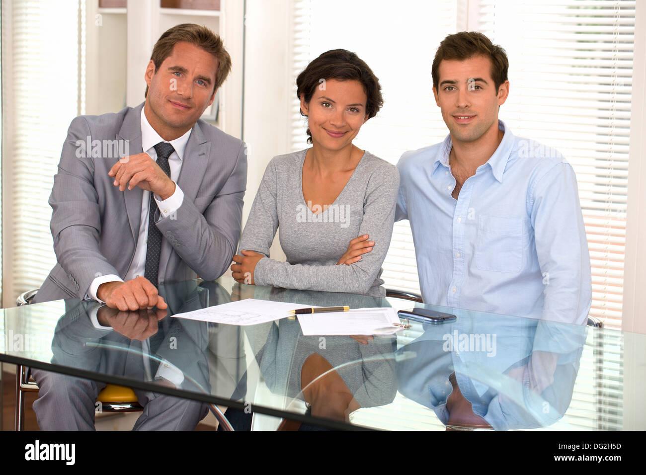 woman man businessman indoor desk contract - Stock Image