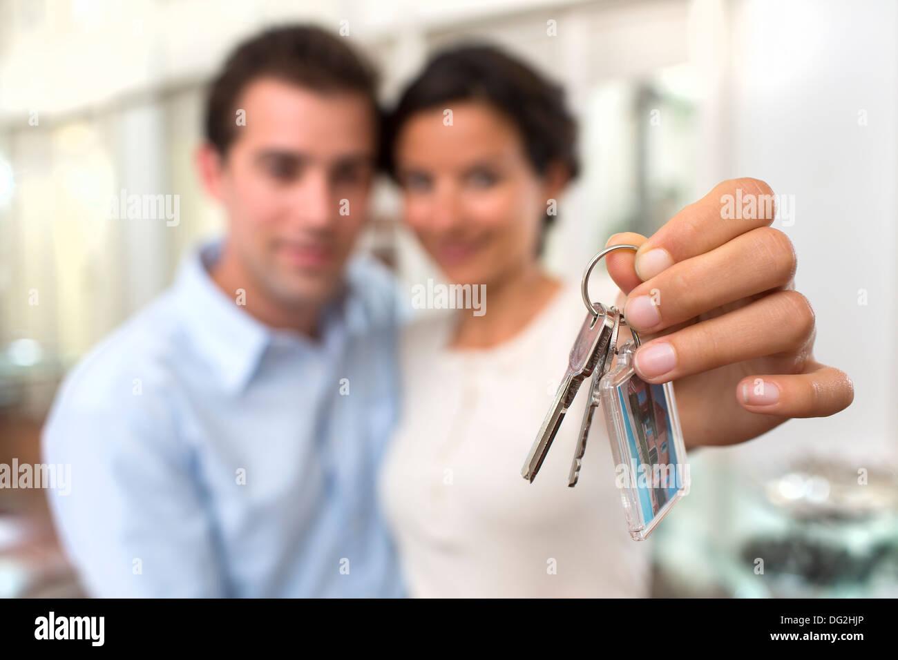 Woman man keys indoor room hand finger - Stock Image