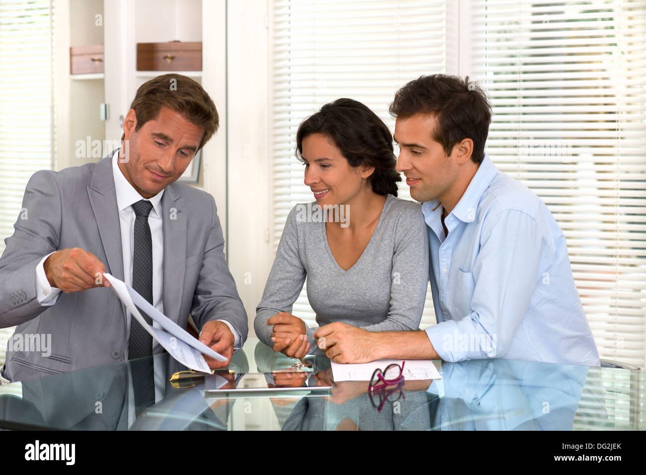 woman man businessman indoor contrat - Stock Image