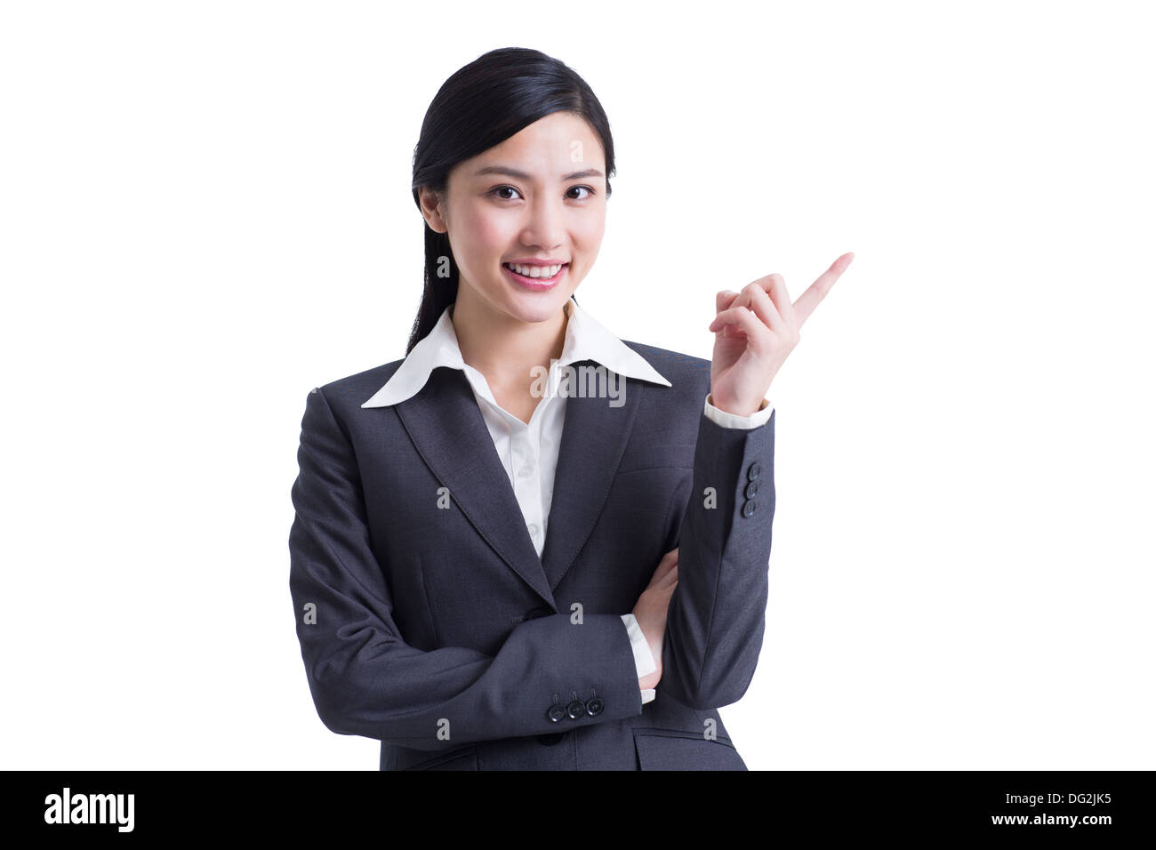 Cheerful businesswoman pointing - Stock Image