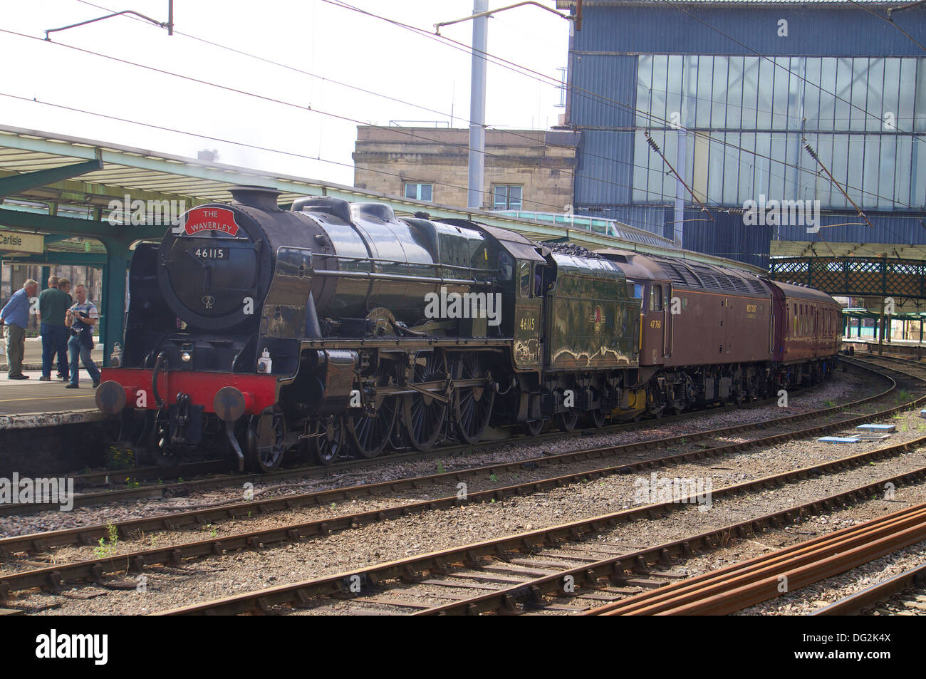 Steam locomotive 'Scots Guardsman' 46115 in Carlisle Railway Station with a special charter train. Carlisle Cumbria England. - Stock Image