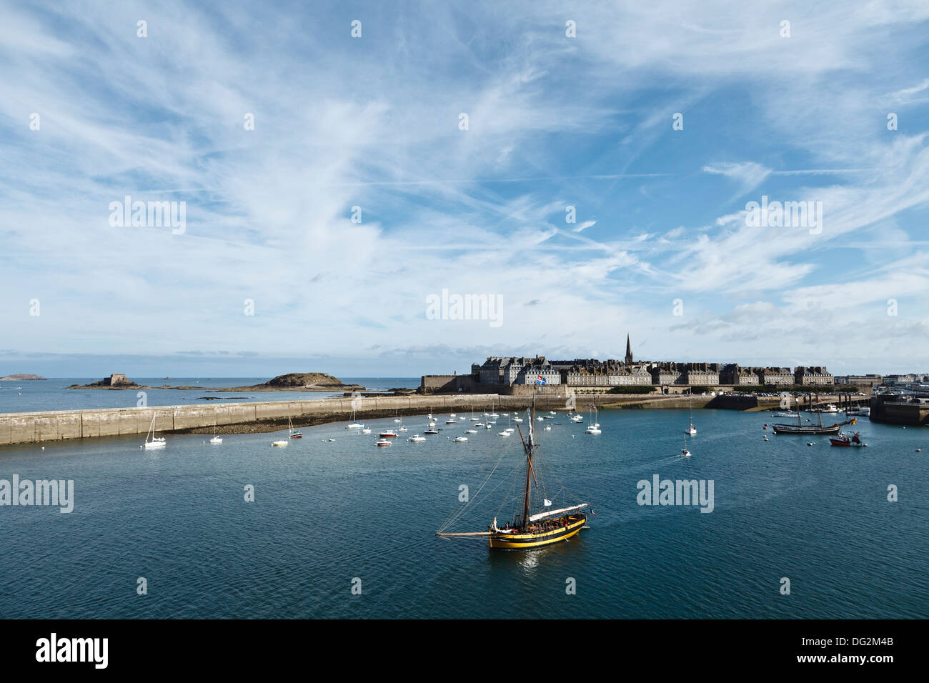 Sailing ship leaving Saint Malo harbour, Brittany, France - Stock Image