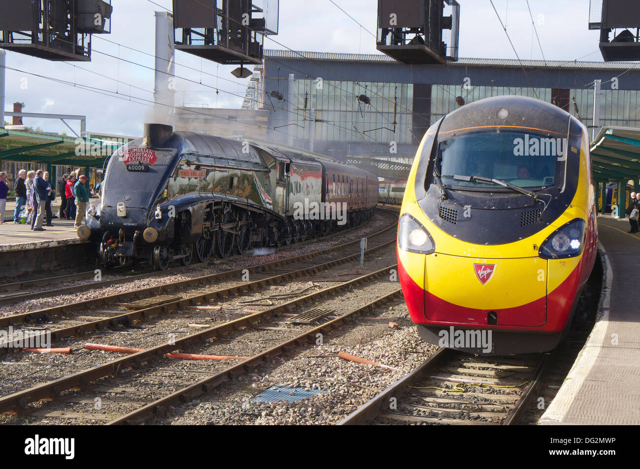 Virgin Pendolino and Steam locomotive 'Union of South Africa' 60009 special charter train in Carlisle Railway Station, Cumbria. - Stock Image