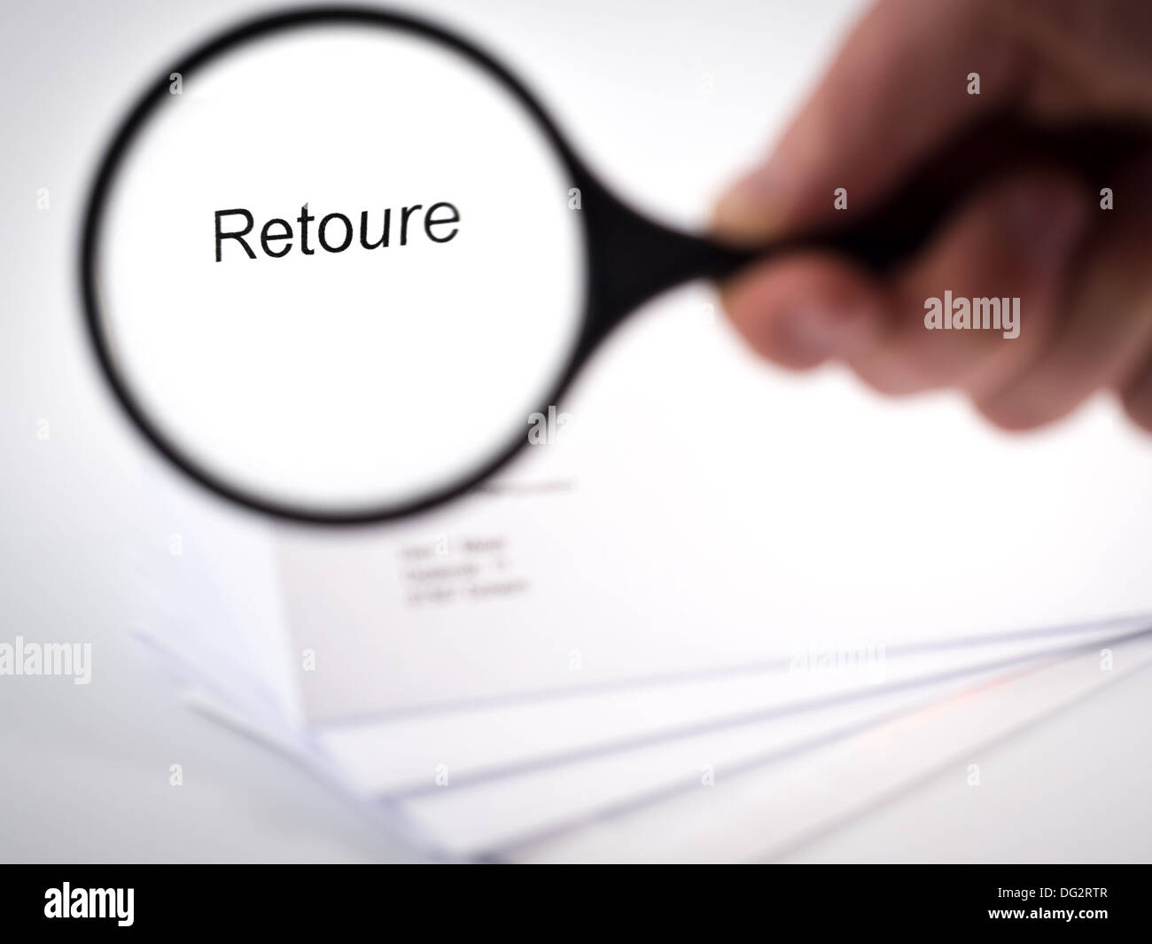 Letter with returns shown by a magnification glass - Stock Image