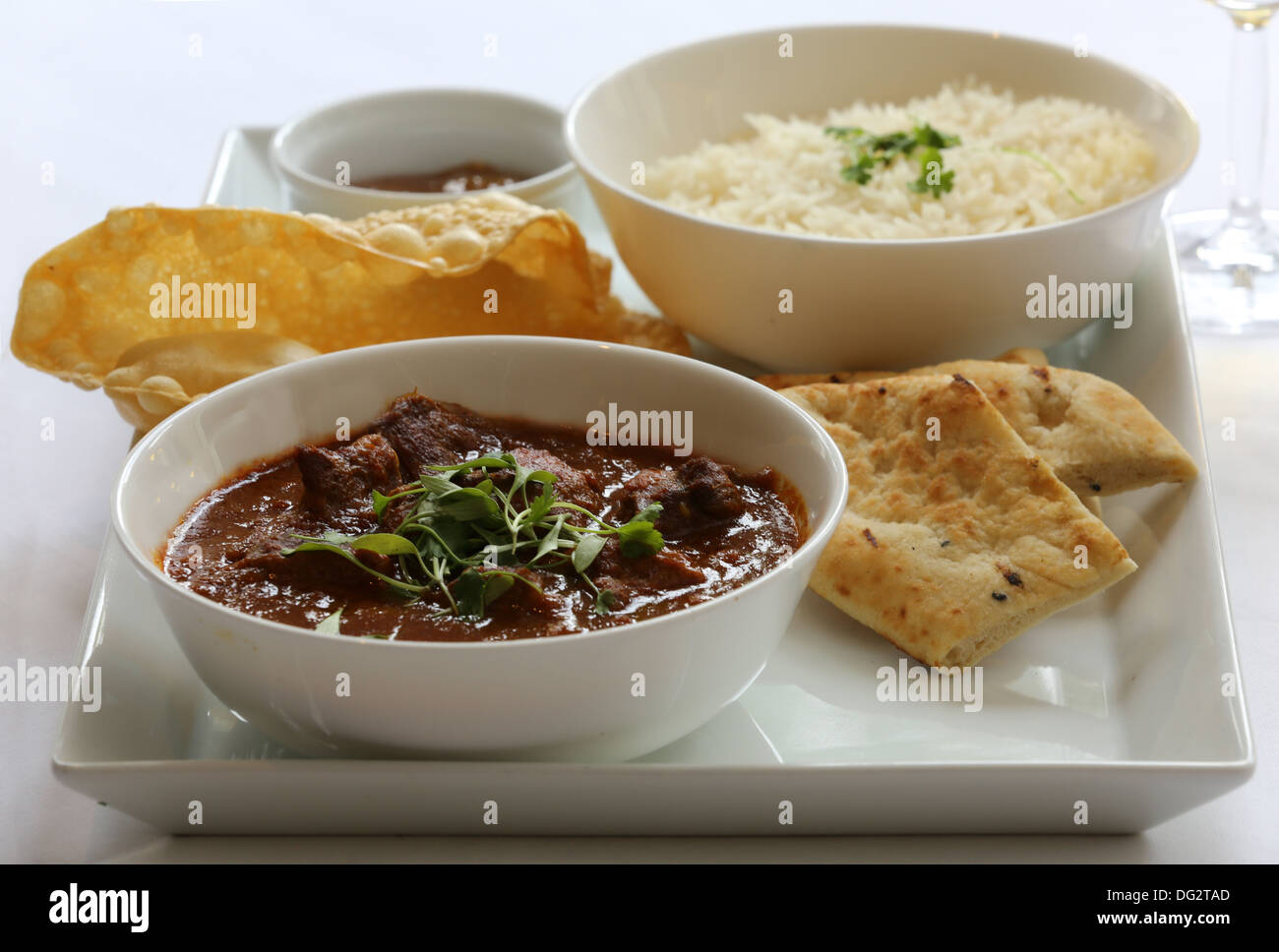 Chicken curry with rice and naan bread - Stock Image
