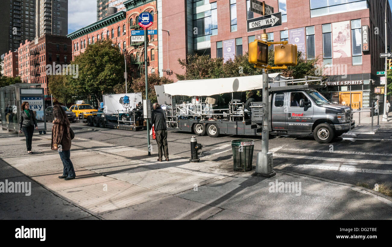 A new Annie (film remake) filming in New York City, while the revival of the original 1977 Broadway musical plays on Broadway, very near this location in Hells Kitchen. The film stars Quvenzhane Wallis & Jamie Foxx. New York City, Oct. 12, 2013, USA - Stock Image