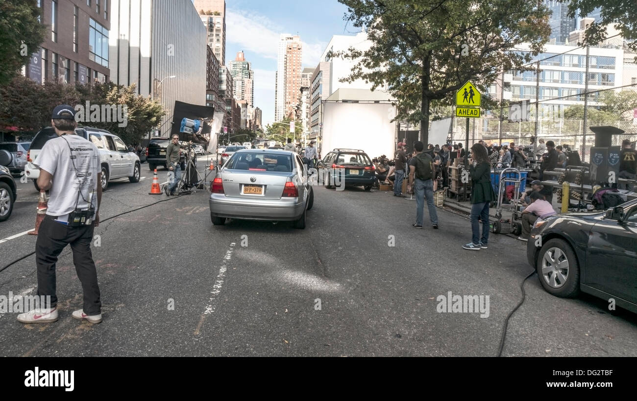A new Annie (remake of 1982 movie musical) filming in New York City, Oct. 12, 2013; while the revival of the original 1977 Broadway musical plays on Broadway, very near this location in Hells Kitchen. The film stars Quvenzhane Wallis & Jamie Foxx. - Stock Image