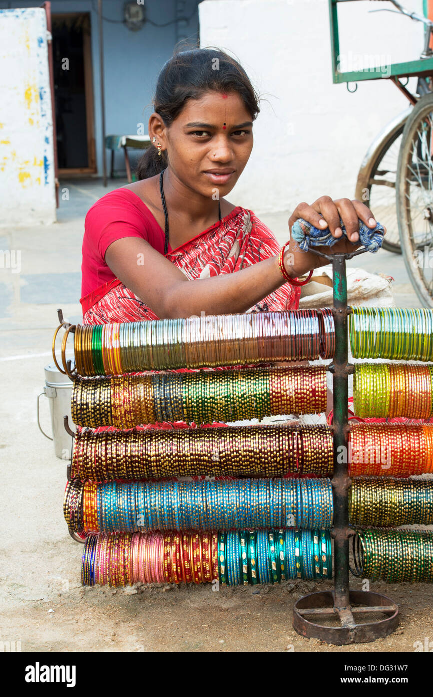 Indian woman selling bangles on the street. Andhra Pradesh, India - Stock Image