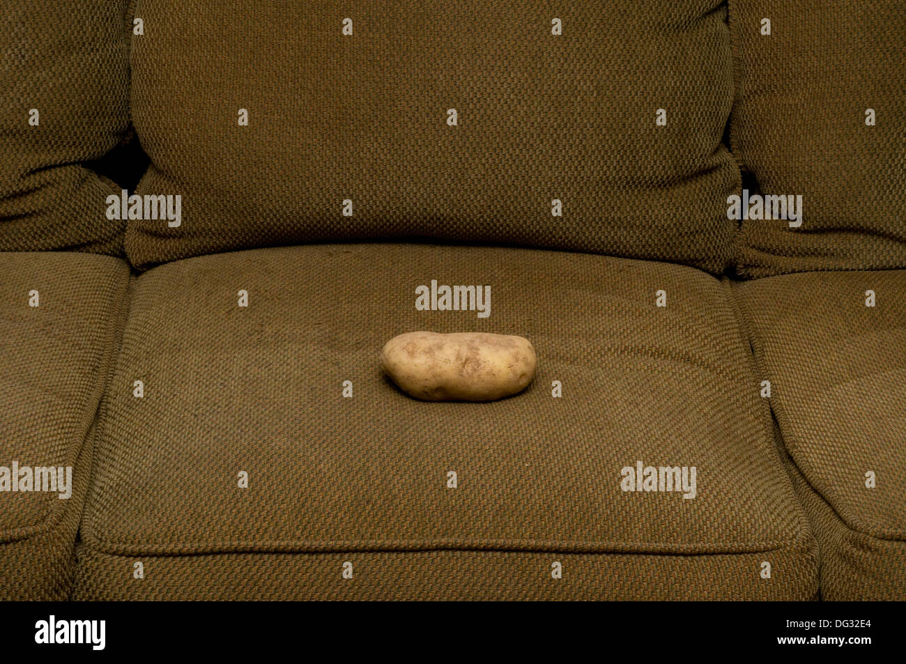 conceptual image - couch potato - Stock Image