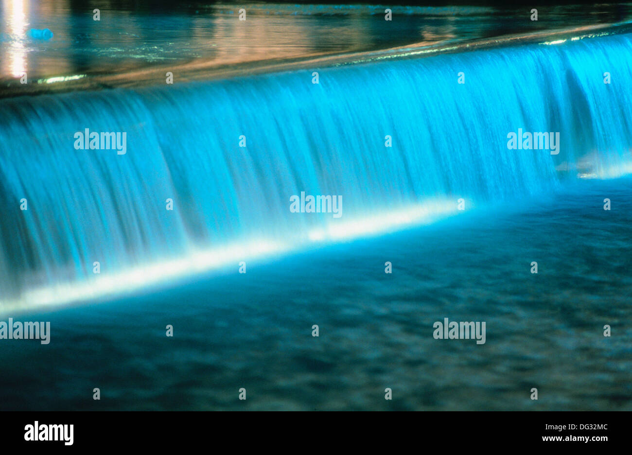 Water cascades in a water feature in a water display. - Stock Image