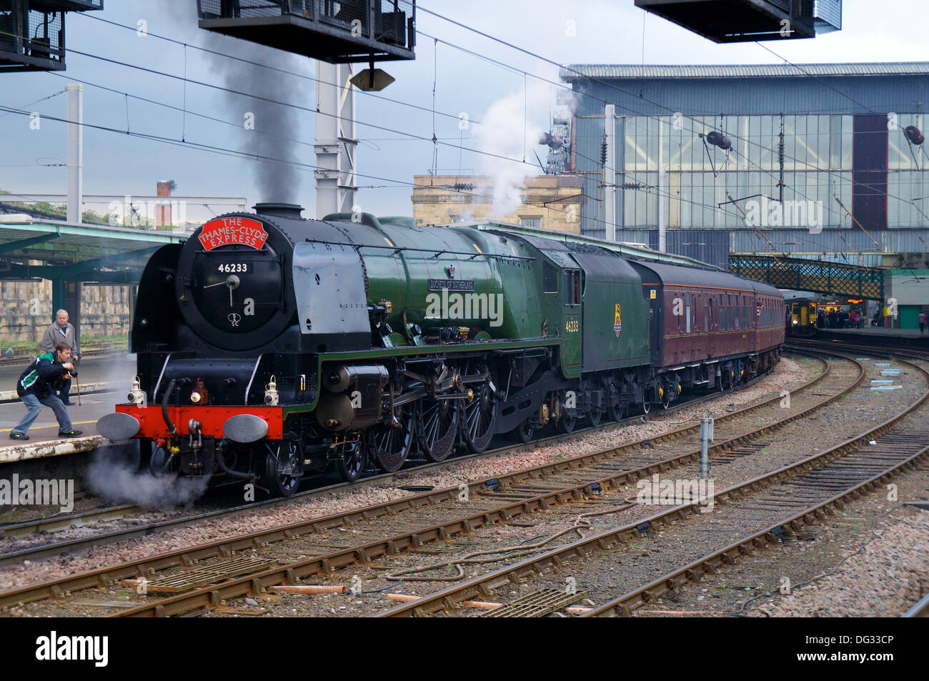 Steam locomotive 'Duchess of Sutherland' 46233 in Carlisle Railway Station with a special charter train. Carlisle Cumbria - Stock Image
