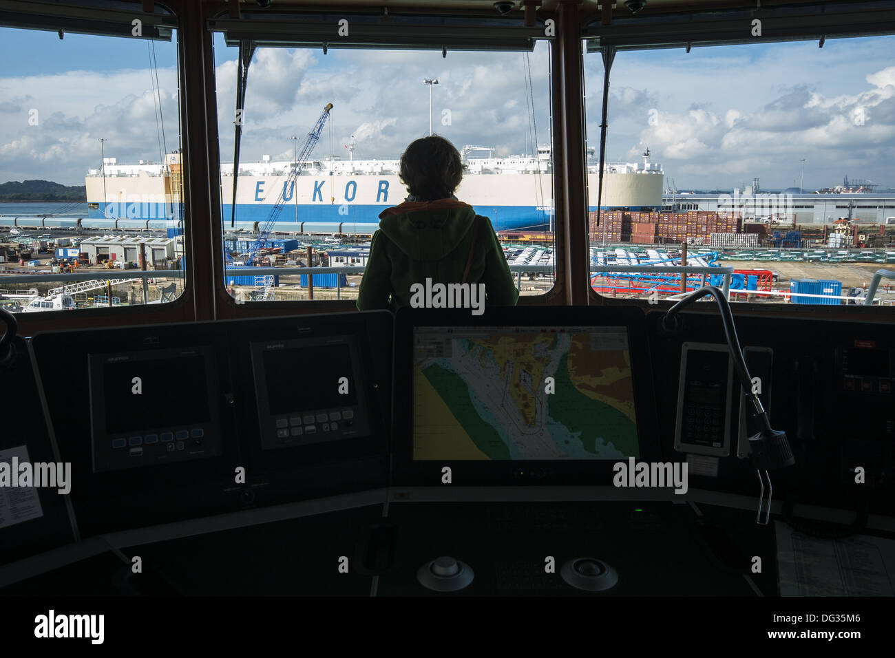Person on the bridge of the RRS Discovery ship research vessel docked in Empress Dock, Southampton, Hampshire, England, UK - Stock Image