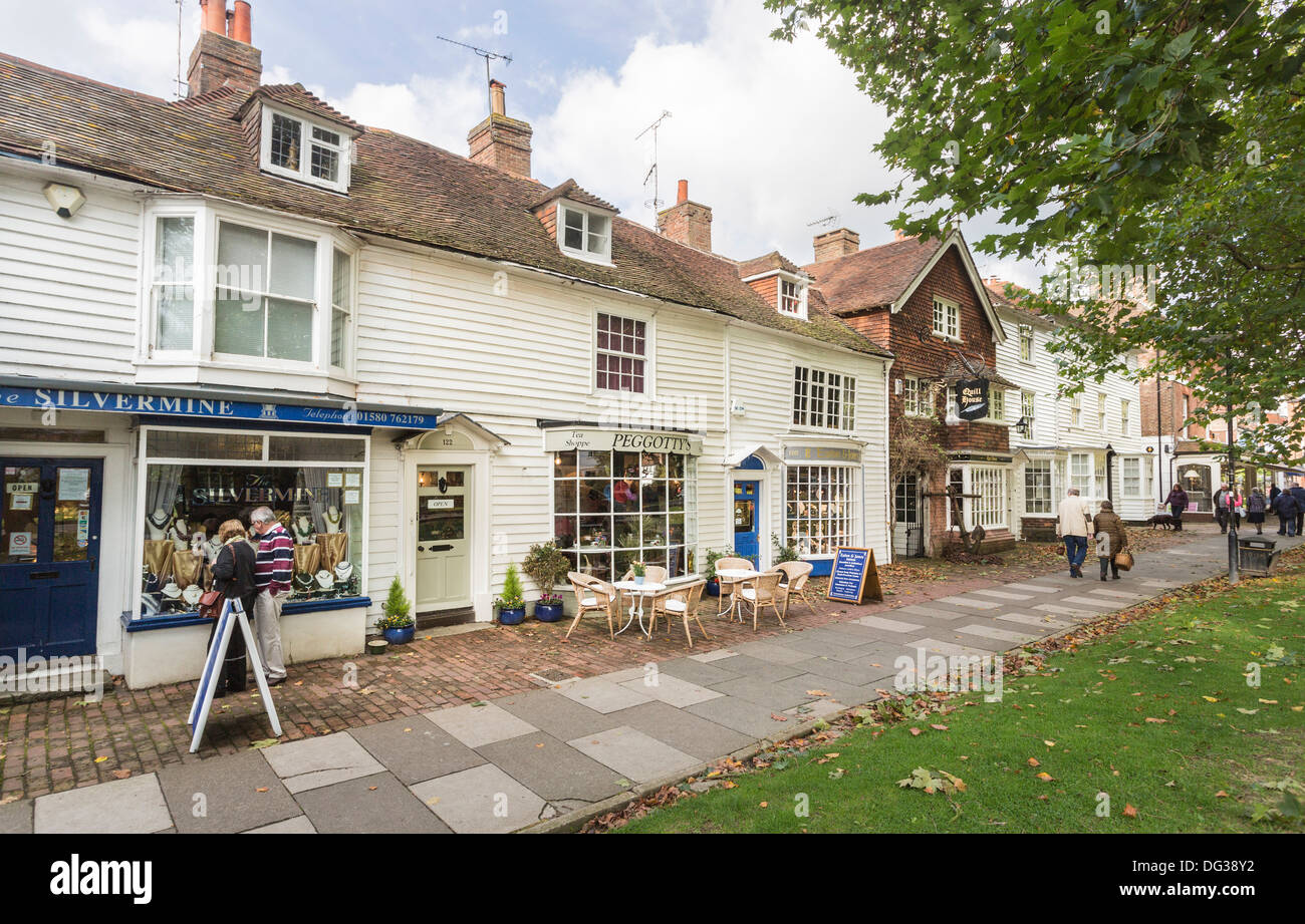 Street scene with Peggotty's Tea Shoppe and traditional clapboard or weatherboarded buildings in Tenterden, Kent - Stock Image