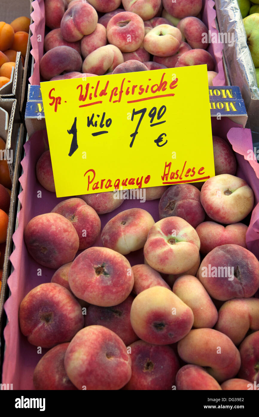 Saturn peaches or Donut (Doughnut) peaches, Prunus persica var. platycarpa, at a market stall, Hanover, Lower Saxony, - Stock Image