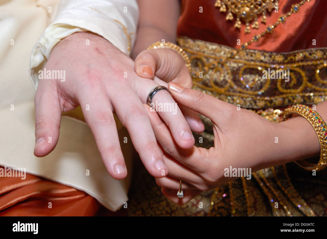 Wearing the engagement ring in wedding traditions of Thailand Stock ...