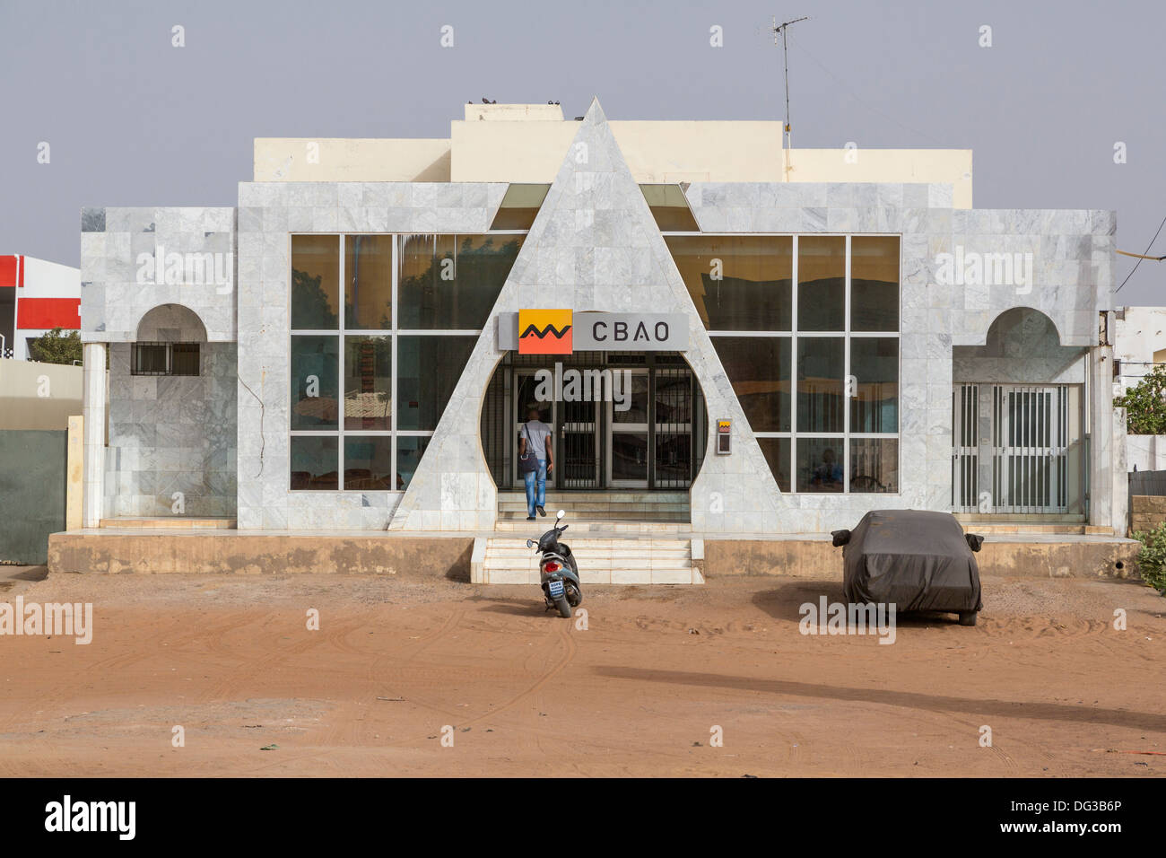 Senegal, Touba. Man Entering CBAO, a Private Bank Headquartered in Dakar. (Compagnie Bancaire de l'Afrique Occidentale). - Stock Image