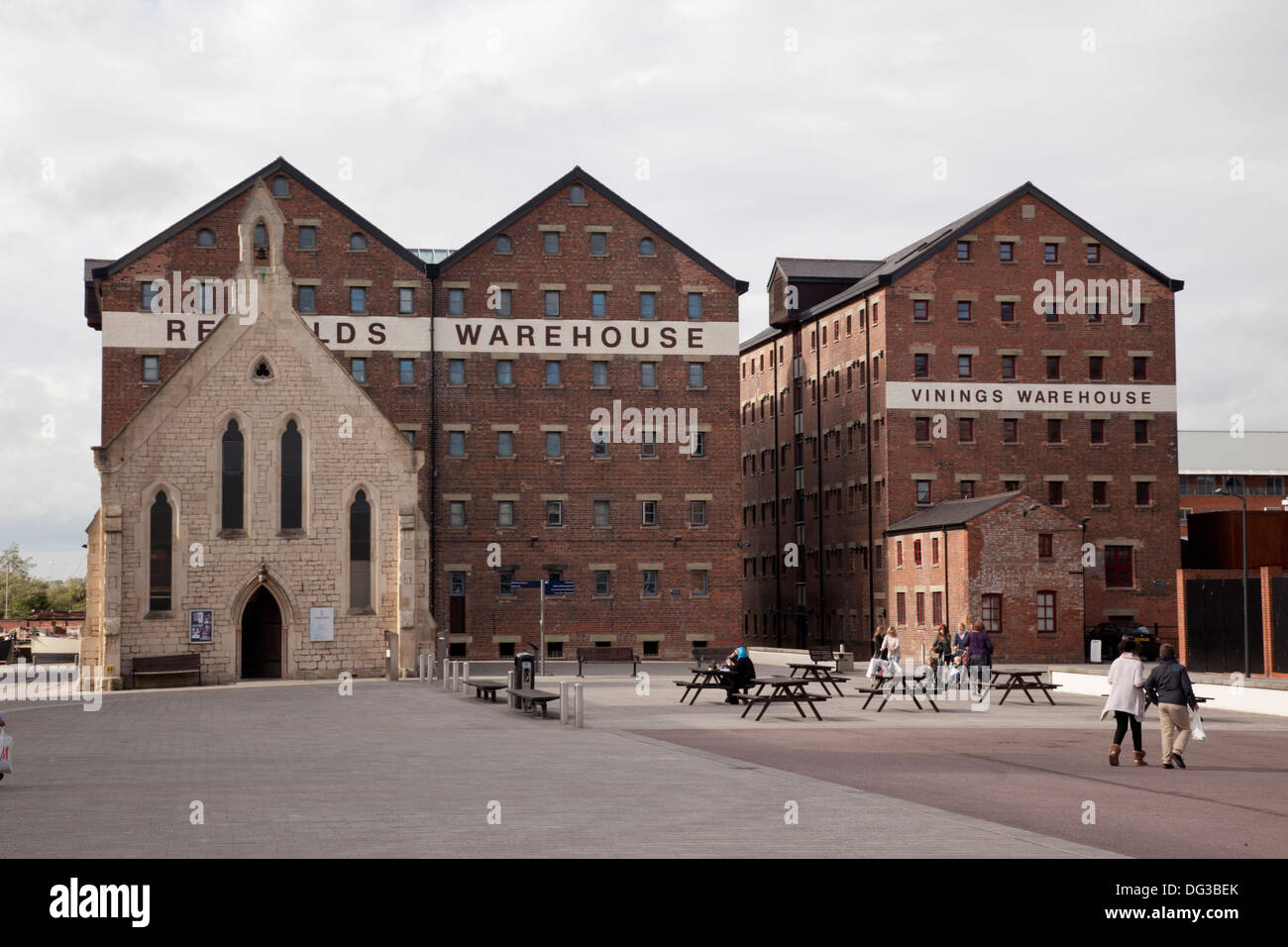 Red bricked warehouses and Mariners Church, Gloucester Docks, Gloucestershire, England - Stock Image