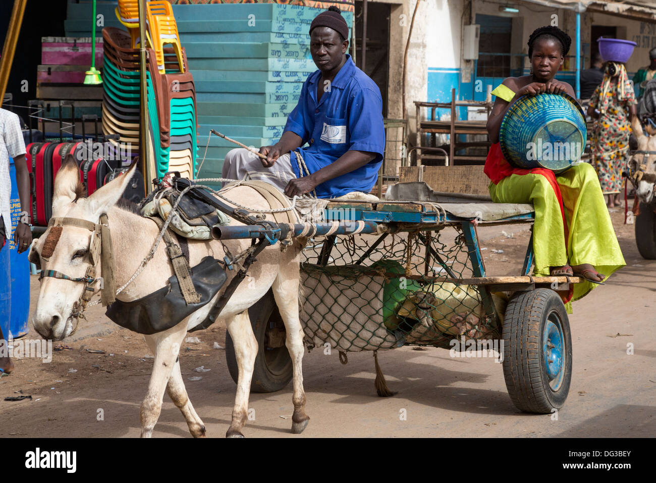 Senegal, Touba. Donkey-drawn Carts Provide Taxi Service for Market Shoppers. - Stock Image