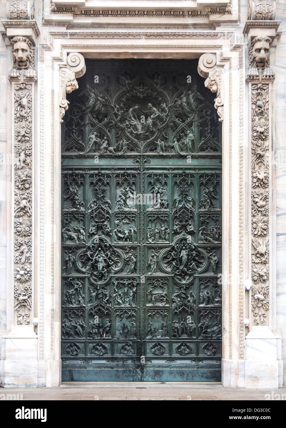 Door detail from the Duomo in Milano, Italy - Stock Image