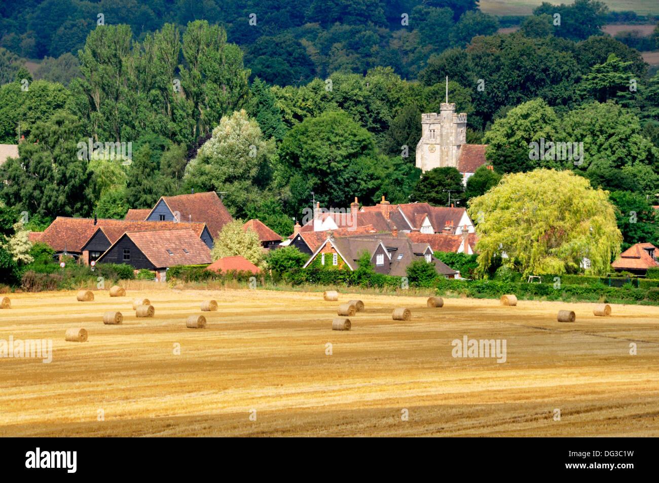Bucks - Chiltern Hills - view to Little Missenden village - across field of golden stubble - straw bales - autumn sunshine - Stock Image