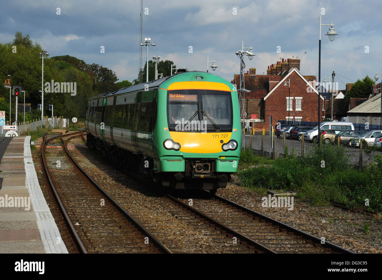 Class 171 Turbostar DMU No 171727 approaching the railway station, Rye, East Sussex, England, UK - Stock Image
