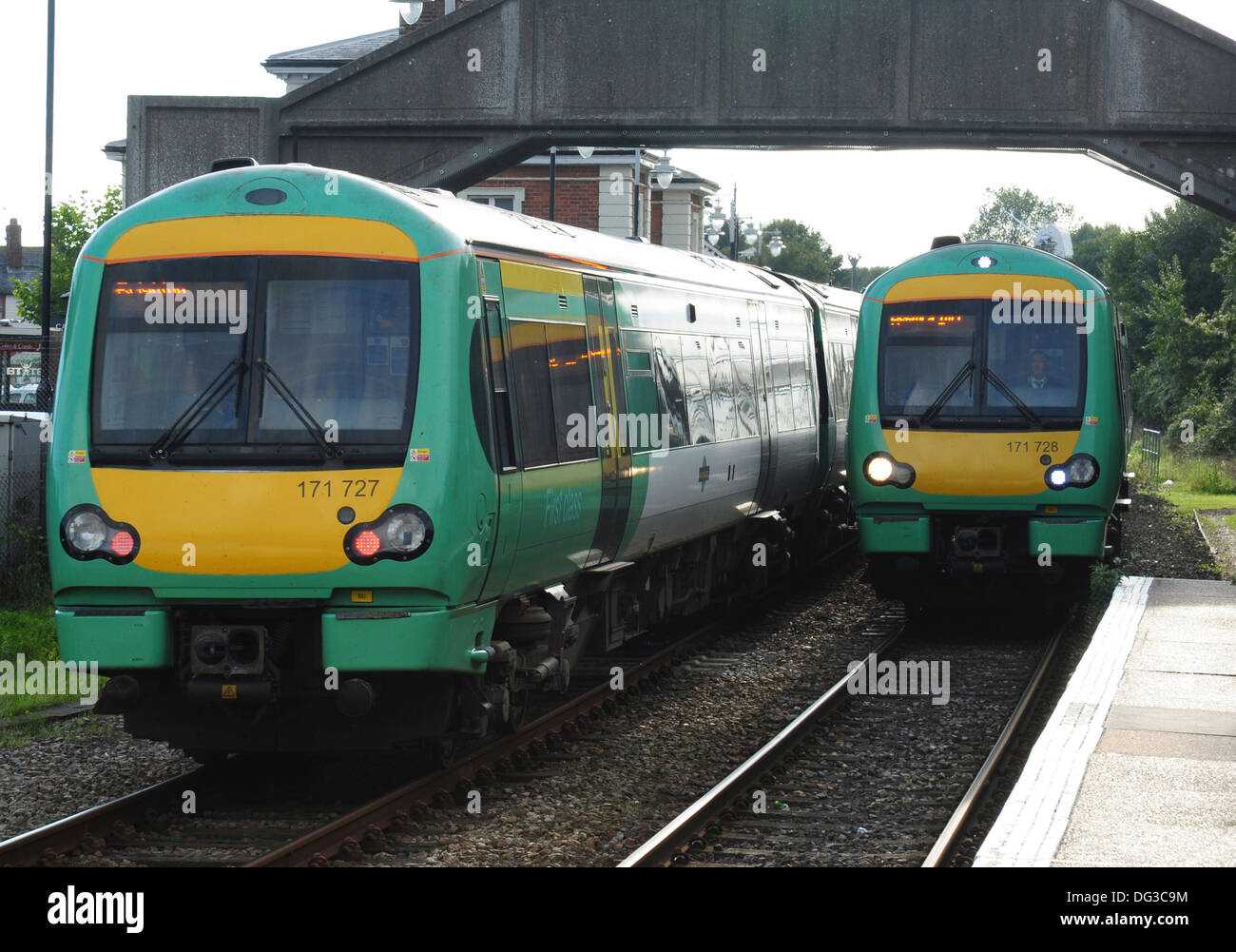 Class 171 Turbostar DMUs Nos 171727 and 171728 passing at the railway station, Rye, East Sussex, England, UK - Stock Image