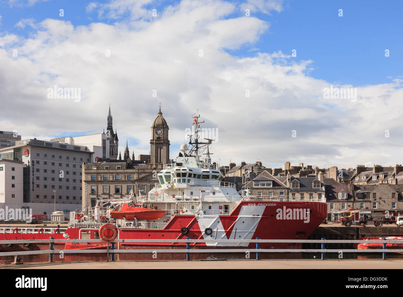 VOS Provider a VROON shipping group North Sea offshore oil supply ship in dock with city centre beyond port of Aberdeen Scotland - Stock Image
