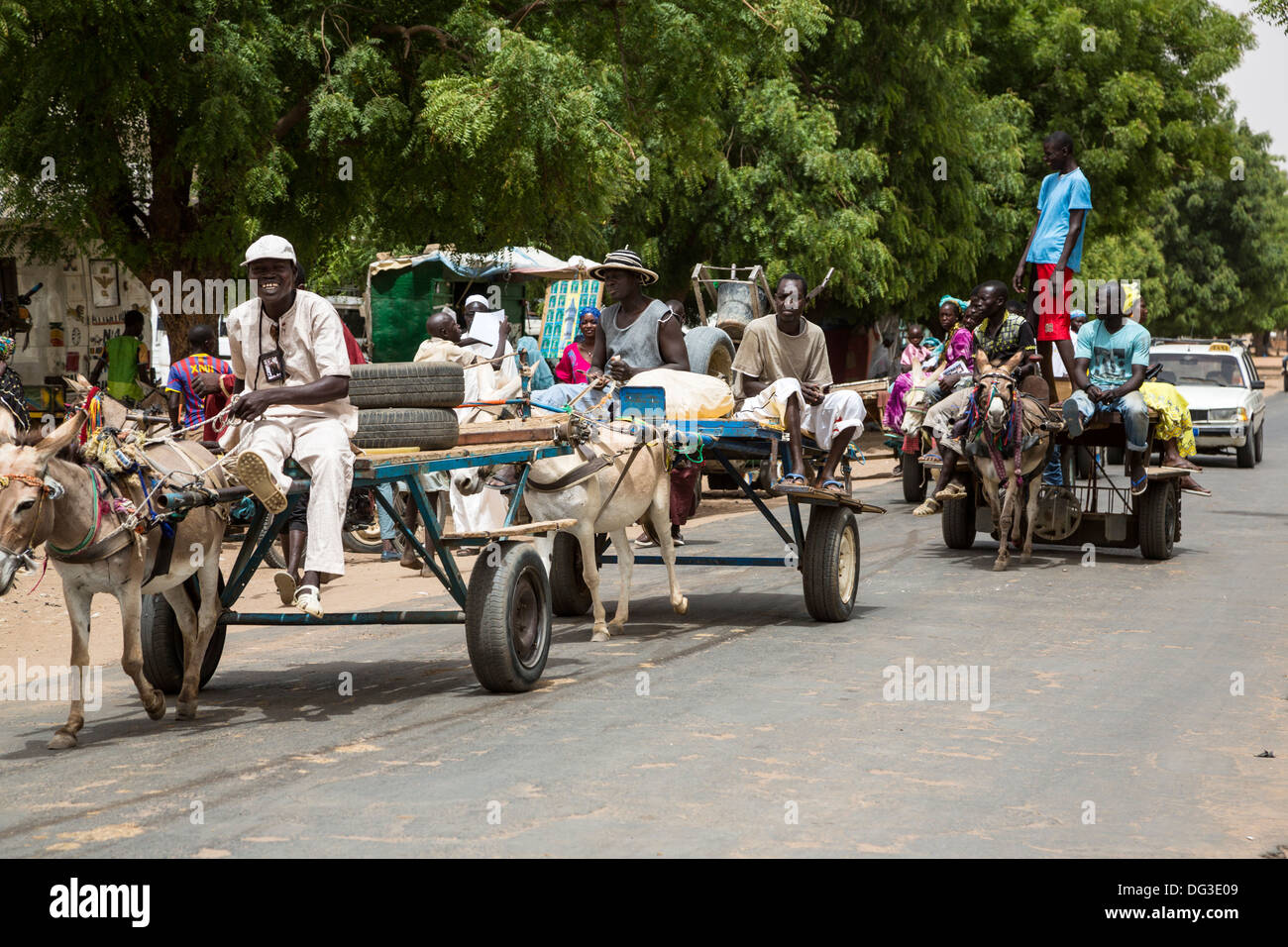 Senegal, Touba. Street Scene. Donkey-drawn Carts and a Taxi Provide Local Transport. - Stock Image