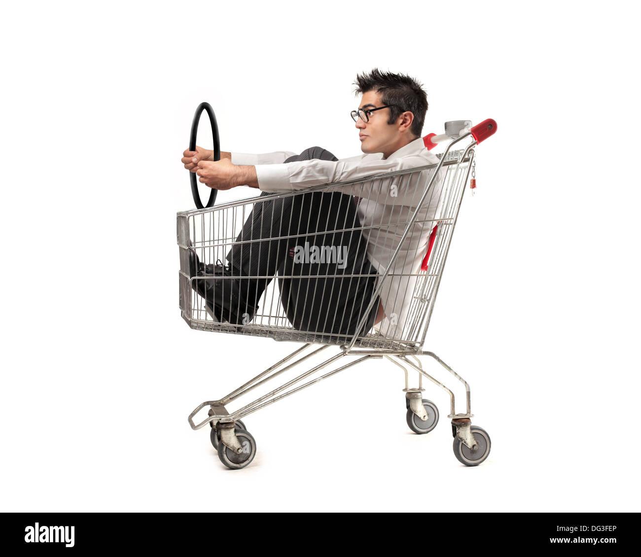 office trolley cart. Office Worker On A Shopping Cart Holding Steering Wheel Trolley