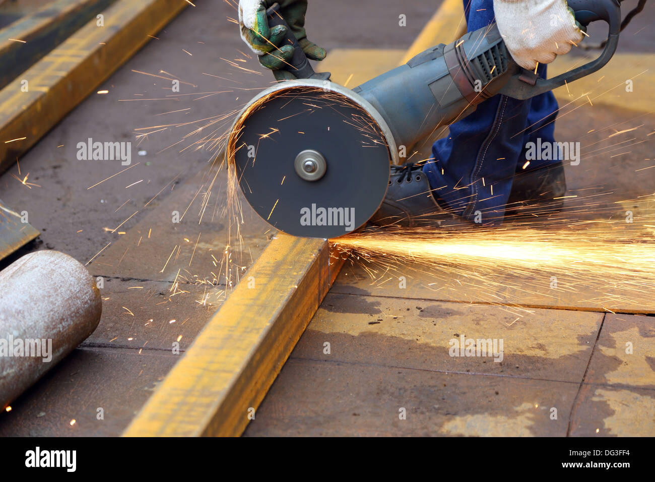 worker cuts metal profile using the hand tool - Stock Image