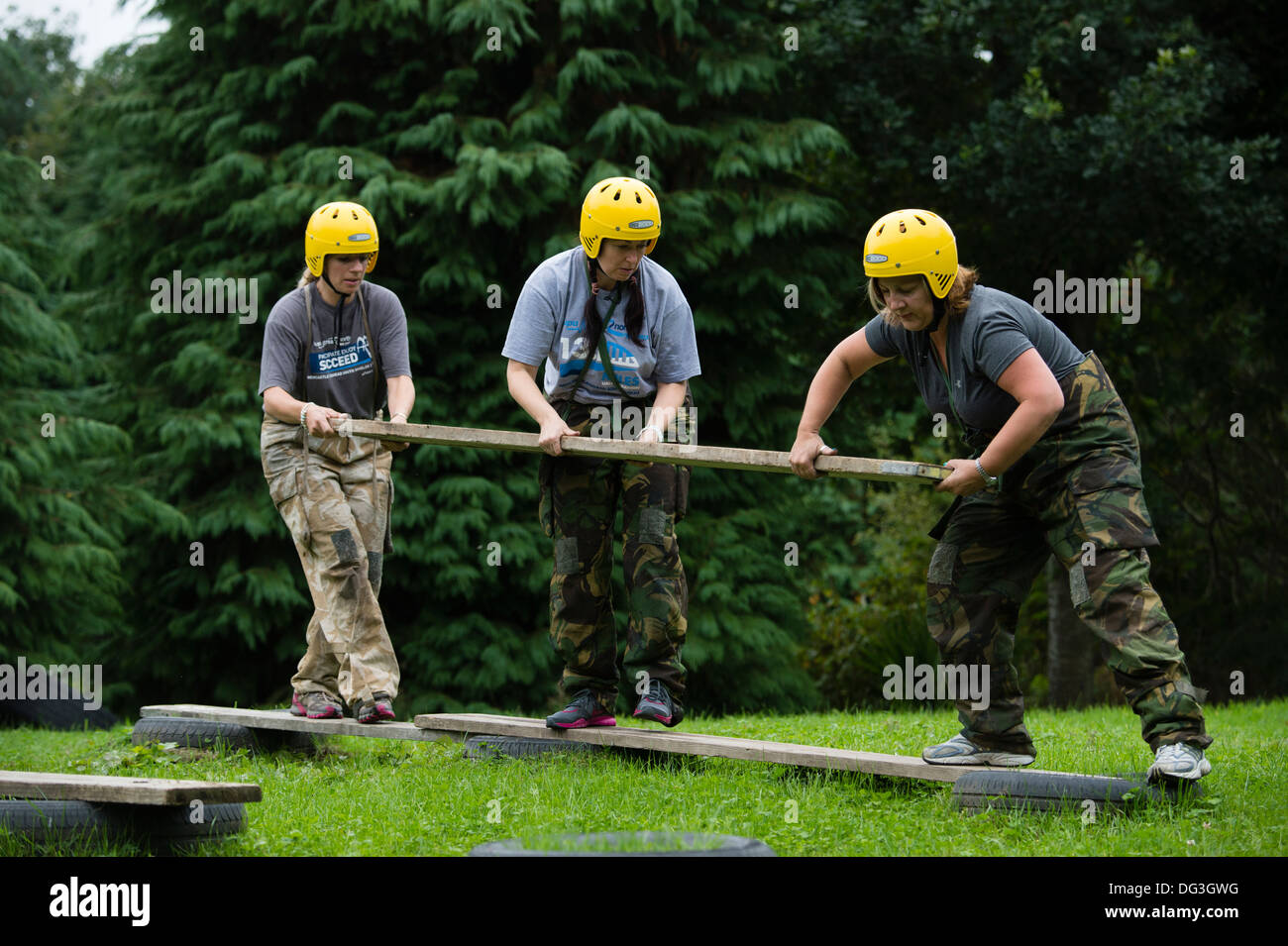 A group of adult women on a team building problem solving outdoor pursuits workshop event UK - Stock Image