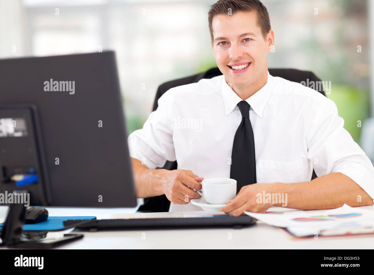 happy young office worker drinking coffee Stock Photo - Alamy