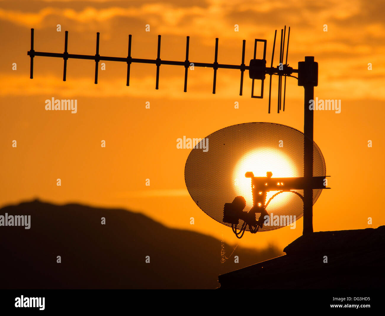 Sunset over a TV aerial in the Lake District, UK. - Stock Image