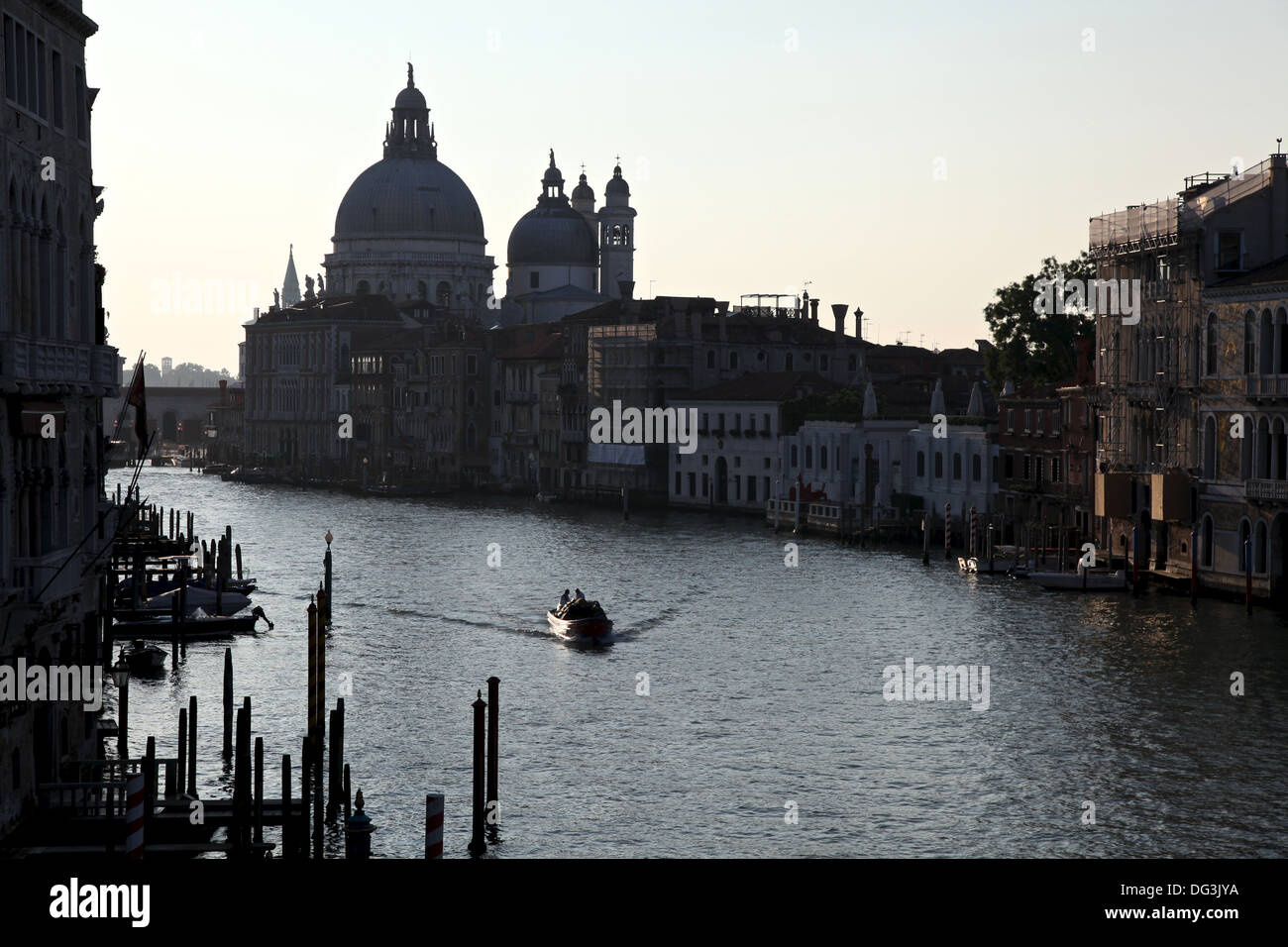 The silhouette of Santa Maria della Salute and adjustent buildings seen from Academia bridge early in the morning Stock Photo