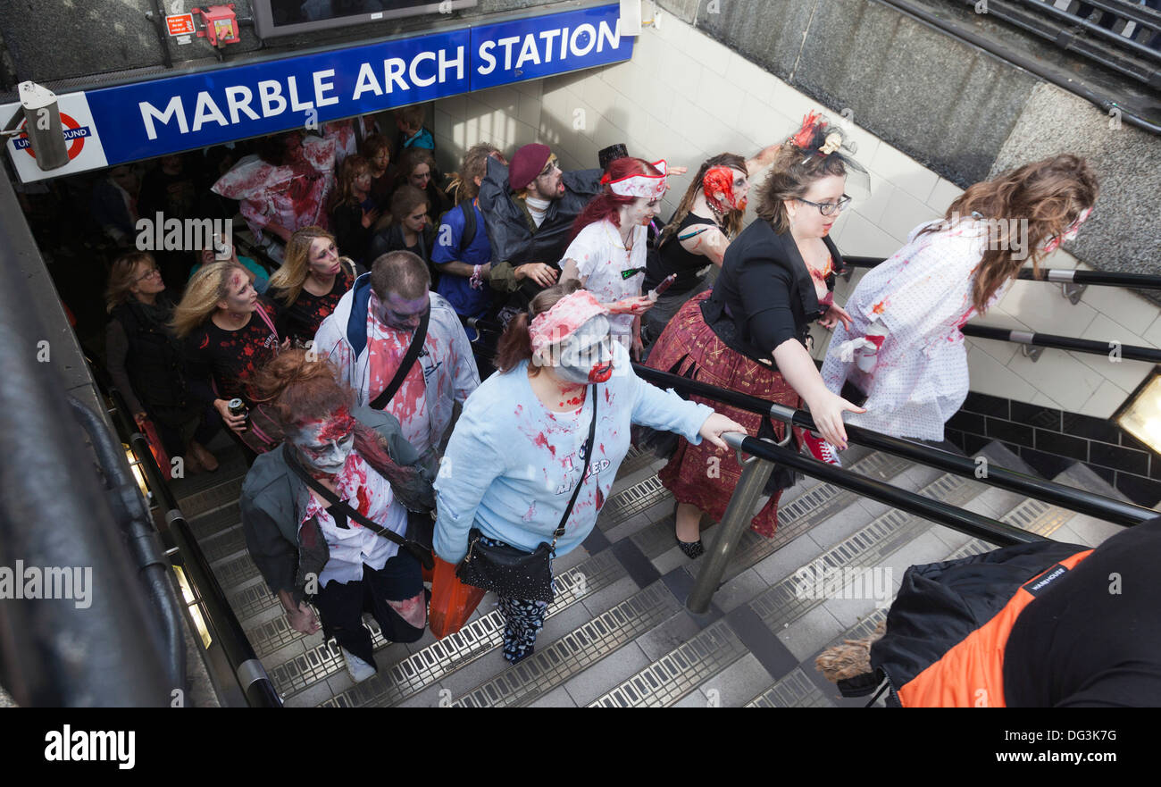 World Zombie Day 2013 in Central London. Zombies coming out of Marble Arch Station. - Stock Image