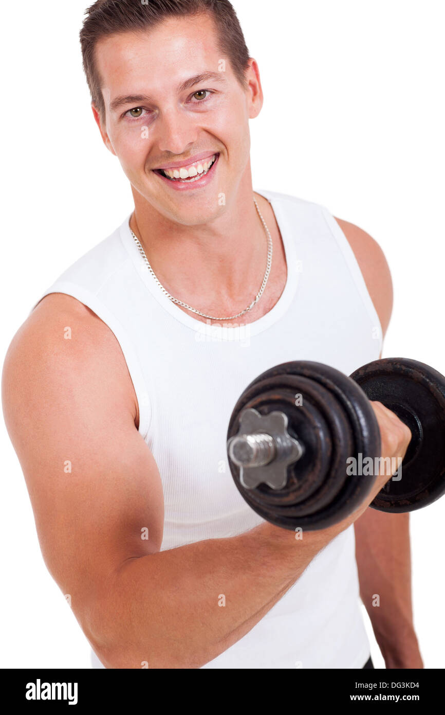 portrait of attractive young man working out with dumbbells - Stock Image