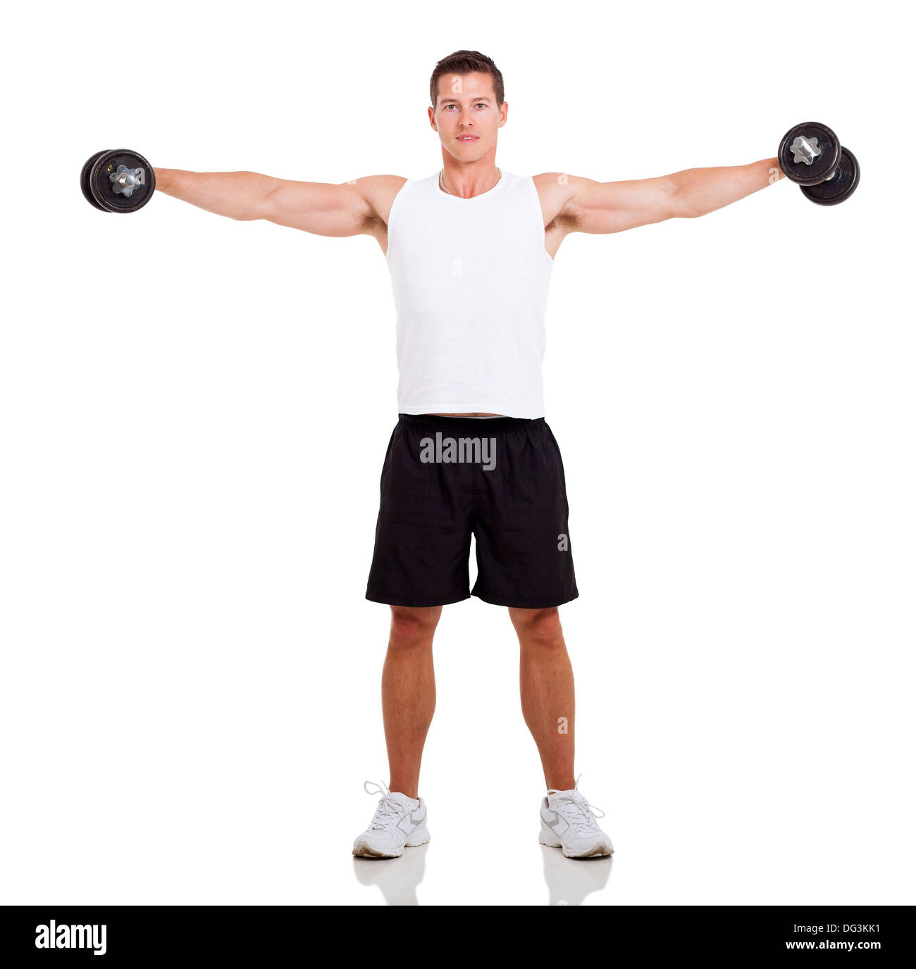 healthy man working out with dumbbells over white background - Stock Image