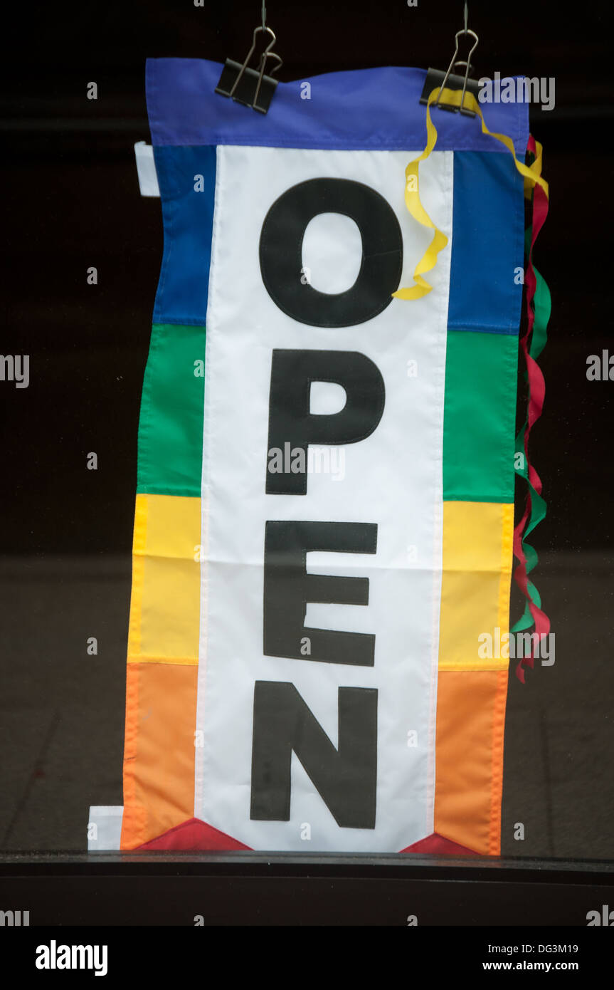 Open sign in front of a store. - Stock Image