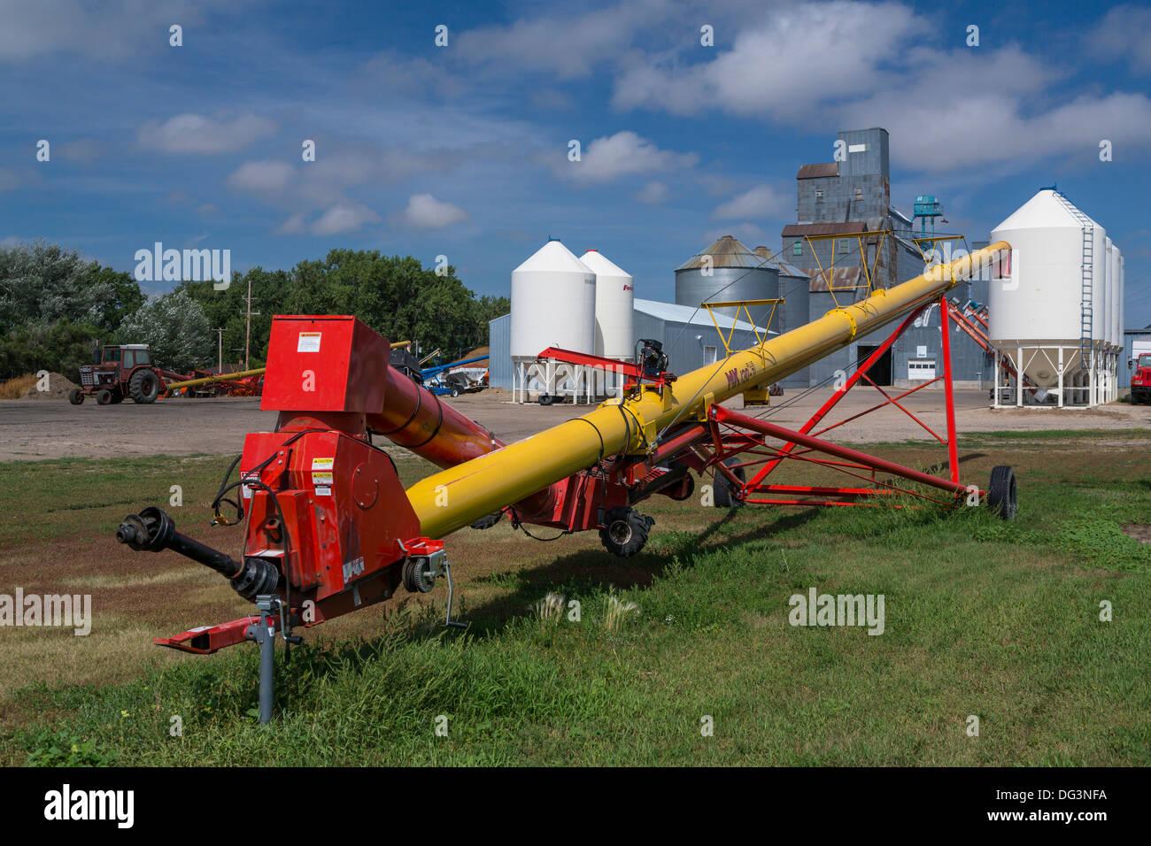 Grain augers and a grain storage facility at Linton, North Dakota, USA. - Stock Image