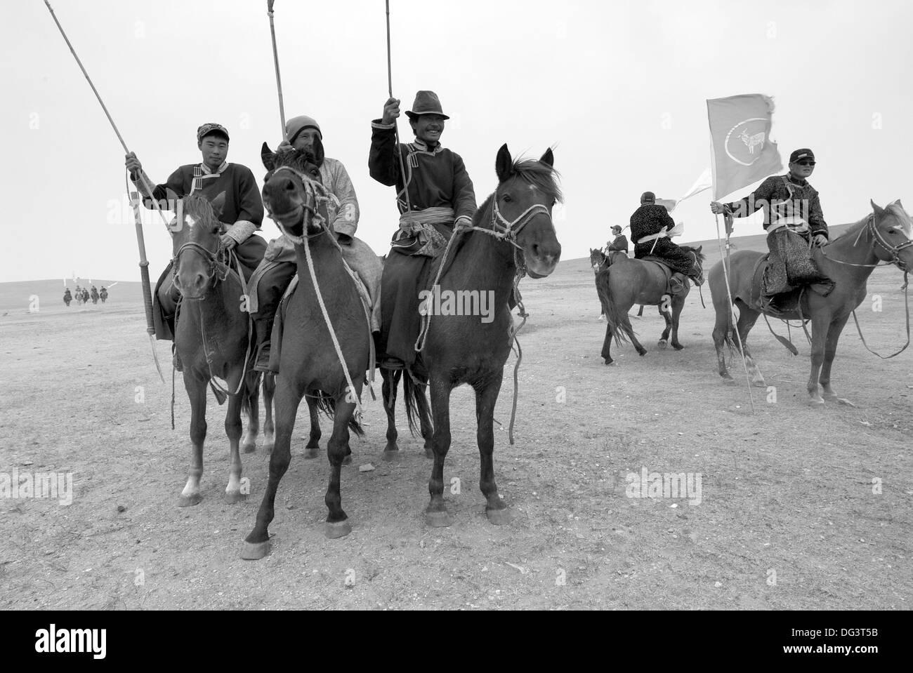 Mongolian horsemen, Xinyou grassland, Inner Mongolia, China - Stock Image