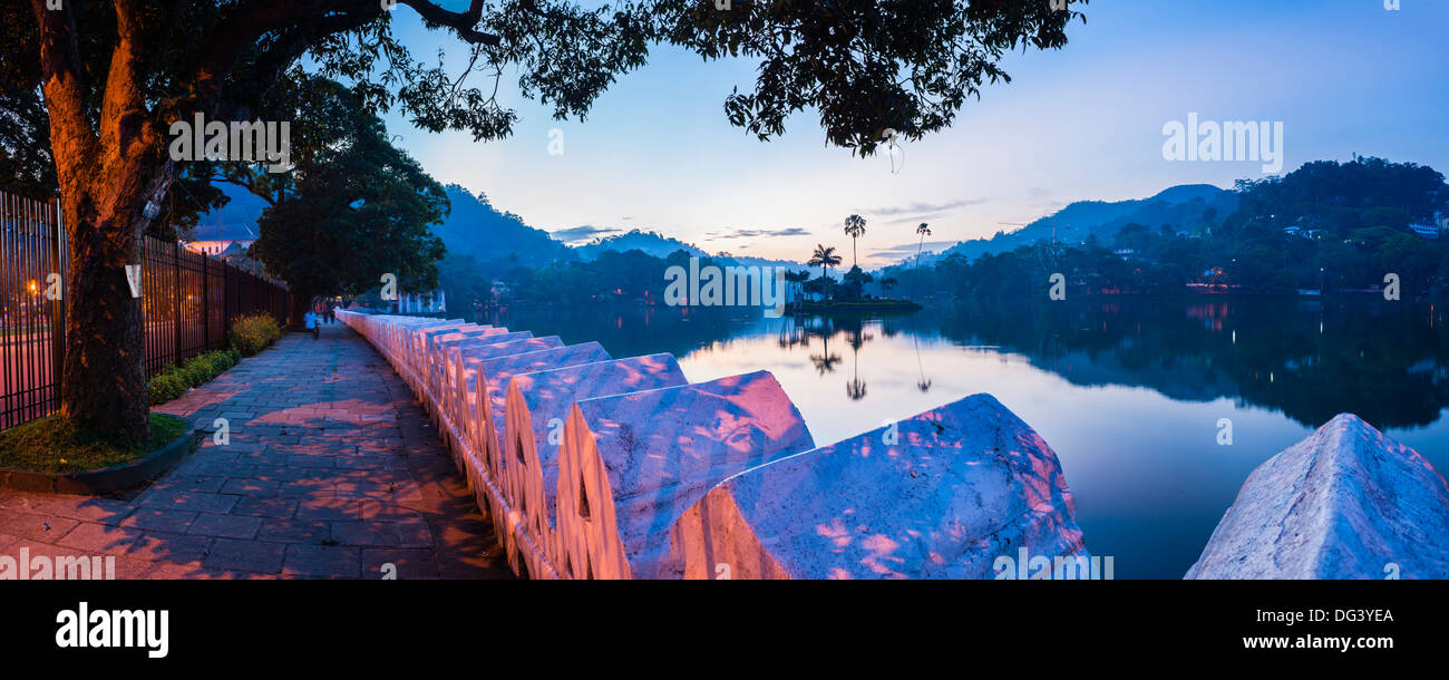 Kandy Lake and the Clouds Wall (Walakulu Wall) at sunrise, Kandy, Central Province, Sri Lanka, Asia - Stock Image