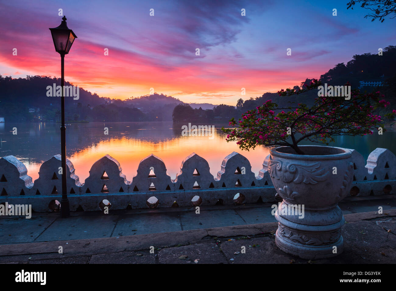 Dramatic sunrise at Kandy Lake and the Clouds Wall (Walakulu Wall), Kandy, Central Province, Sri Lanka, Asia - Stock Image