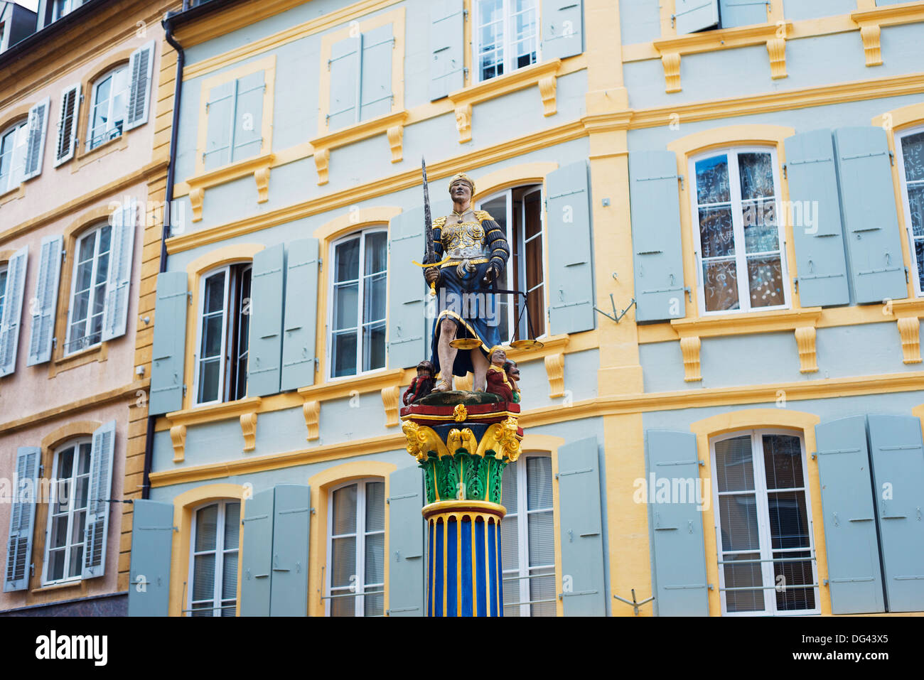Justice statue in medieval old town square, Neuchatel, Switzerland, Europe - Stock Image
