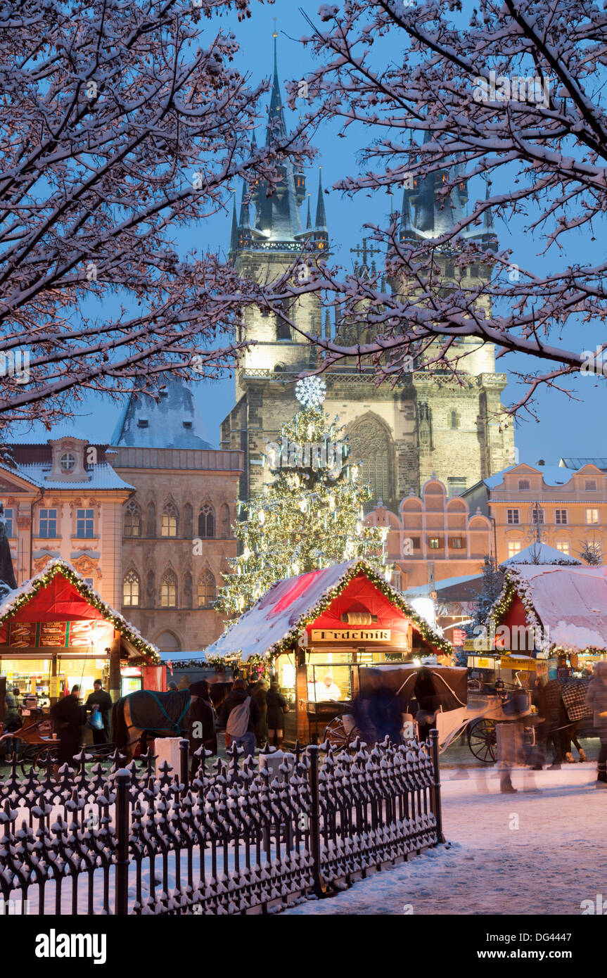 snow covered christmas market and tyn church old town square prague czech